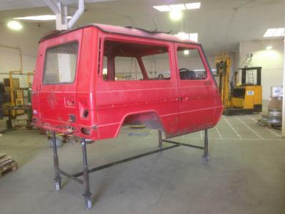 Bare shell on the stand ready for rusty panel removal